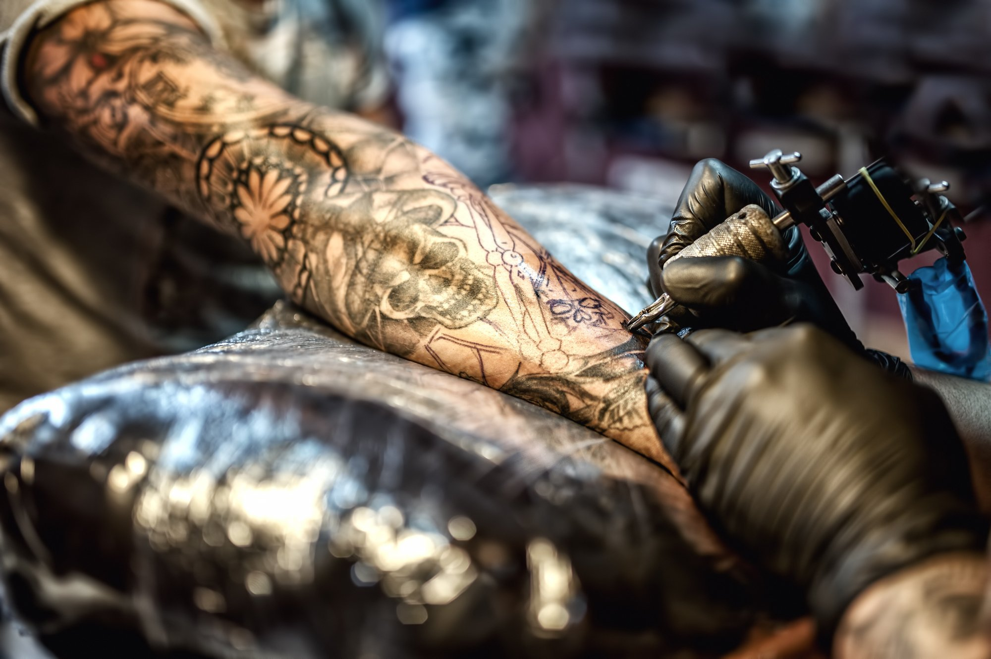 tattoo-artist-drawing-on-arm-and-on-skin-of-client